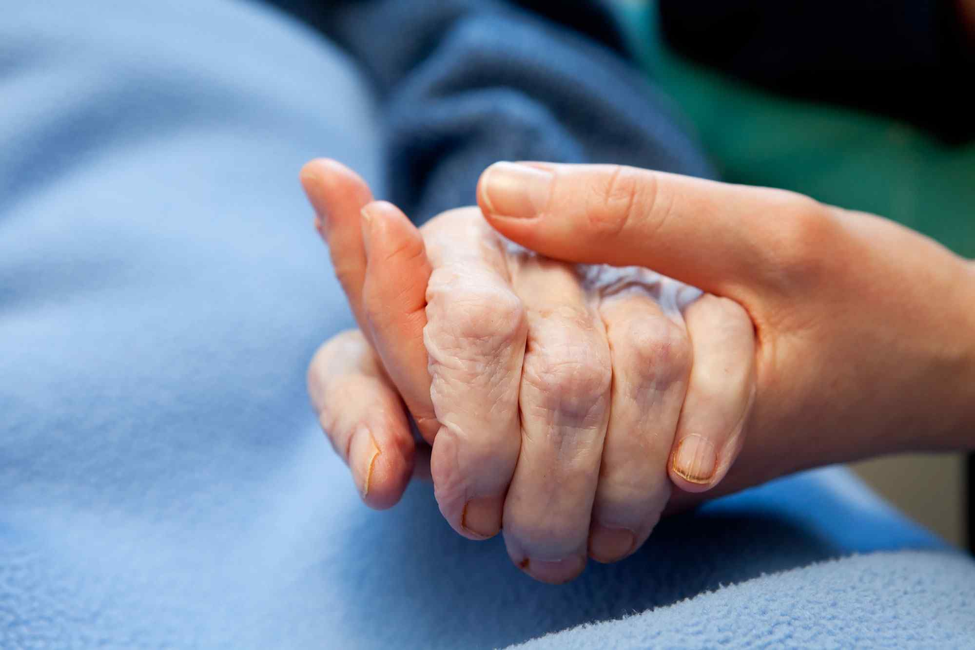 Two hands holding each other hoping to find the right home health and hospice answering service