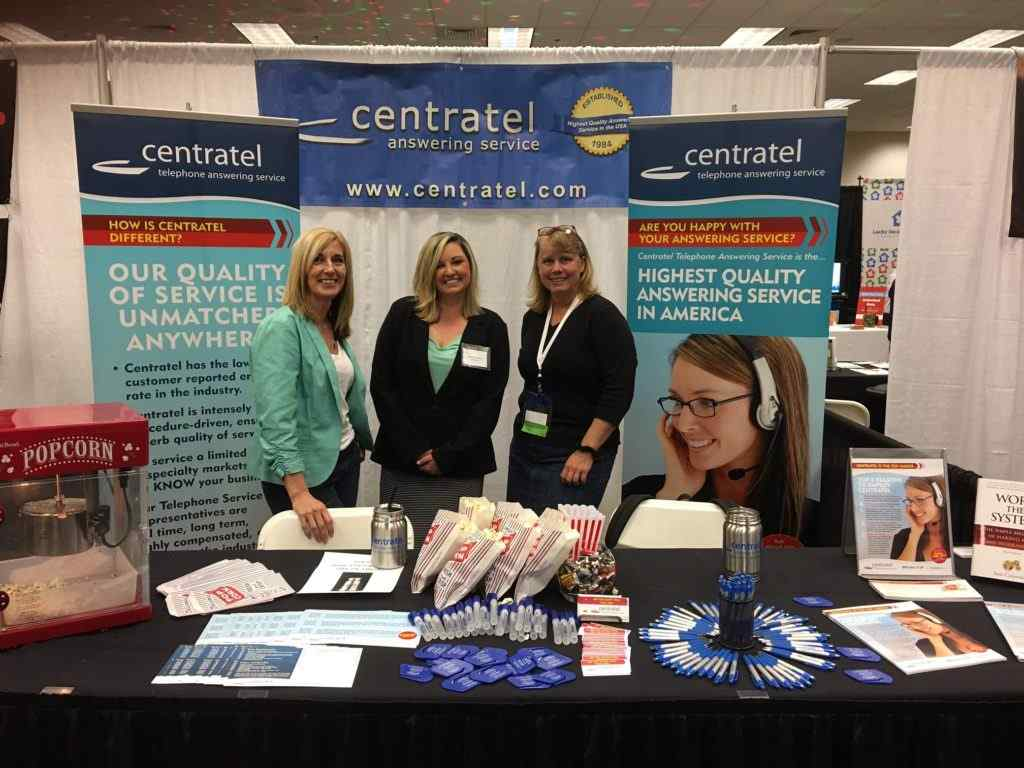 Centratel Telephone Answering Service Staff smiling at a Home Health Care Trade Show