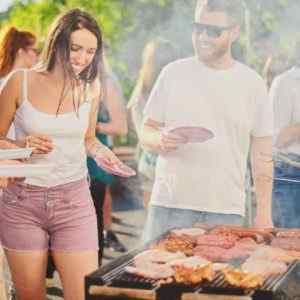 People having fun at a barbeque enjoying the benefits of using an answering service on memorial day