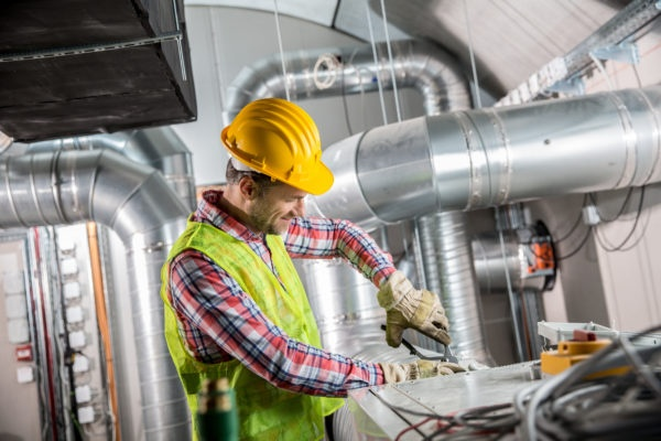 HVAC business owner works happily knowing that calls are managed by an answering service